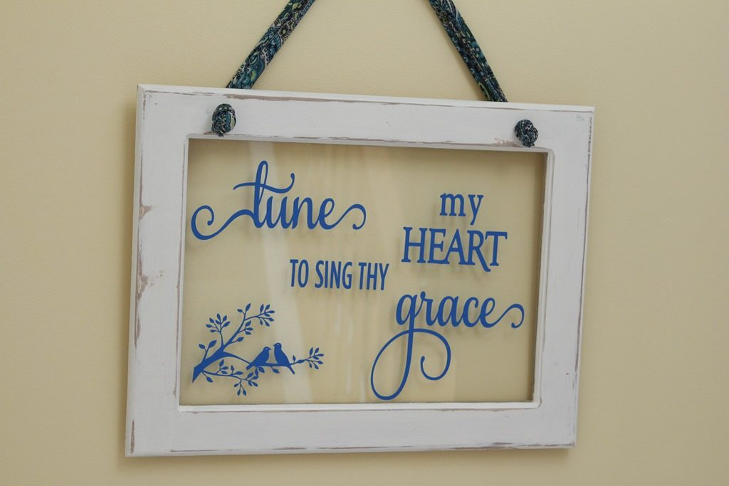 """Tune my heart"" on a window"